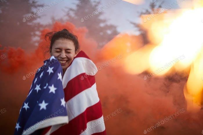 Excited woman against firework