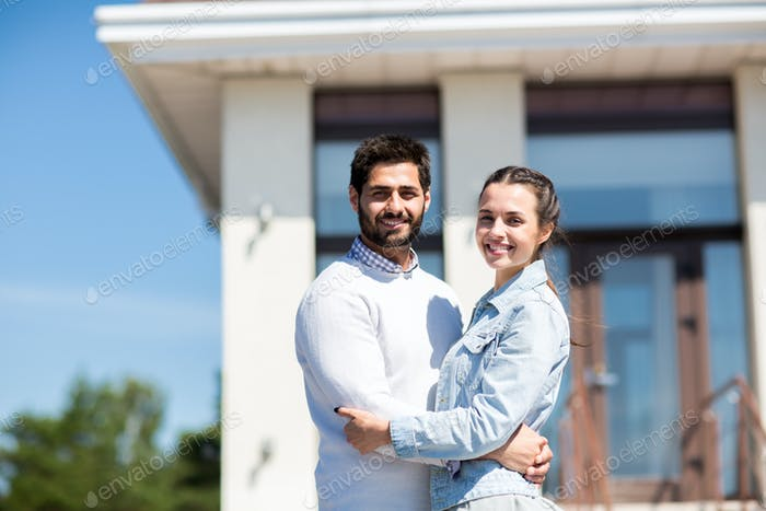 Couple by new house