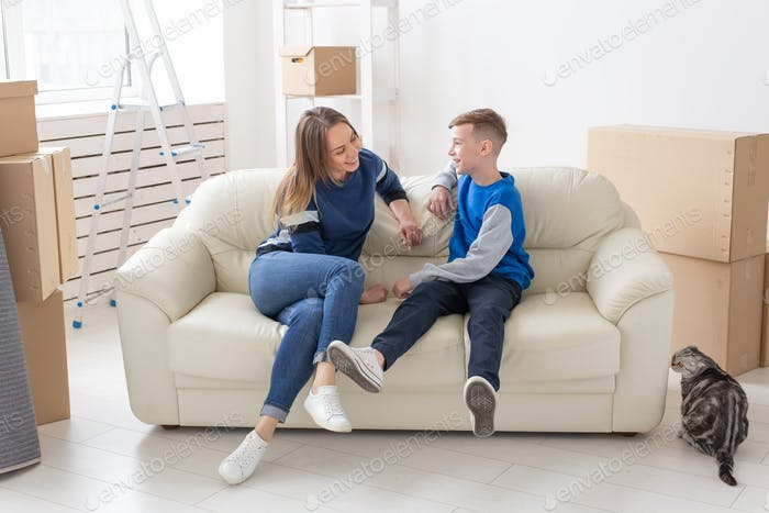 Mother and son happily communicate discussing the design of the new apartment