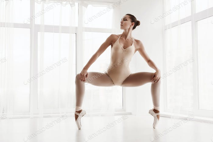 Professional Ballet Dancer Training. Grand Plie In Second Position