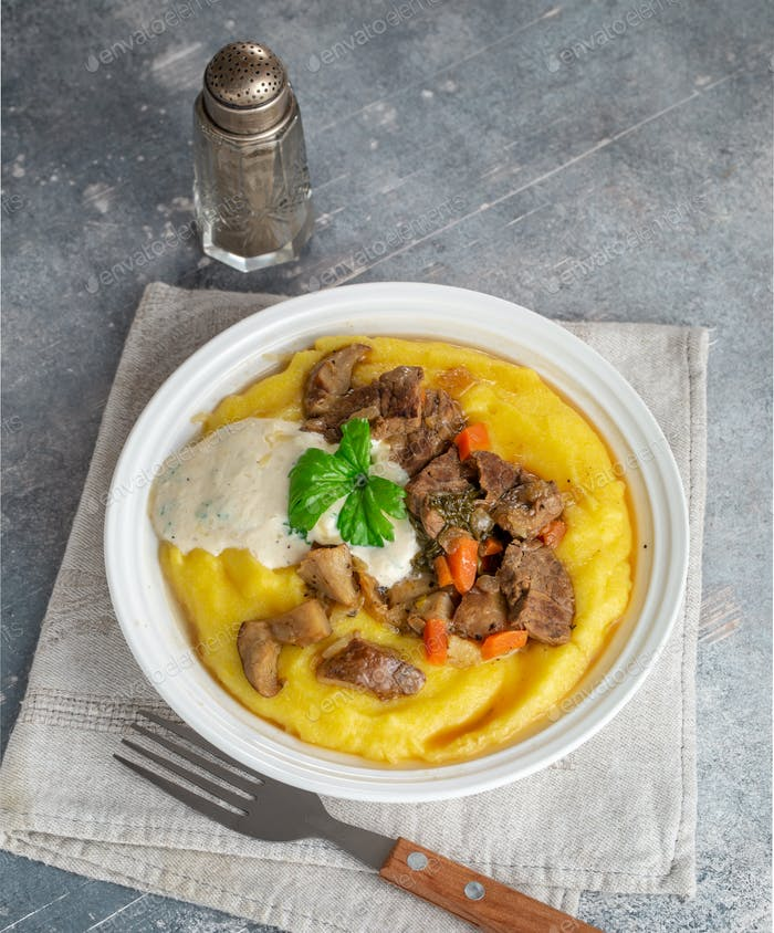 Beef stroganoff over polenta