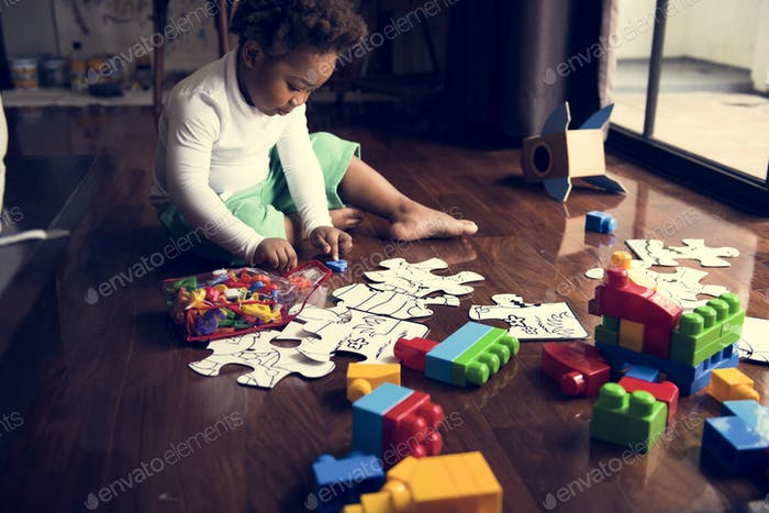 African descent kid enjoying puzzles