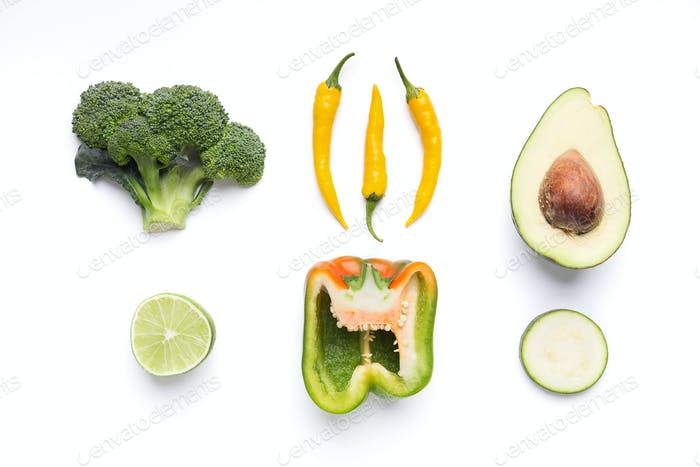 Creative composition of green and yellow vegetables