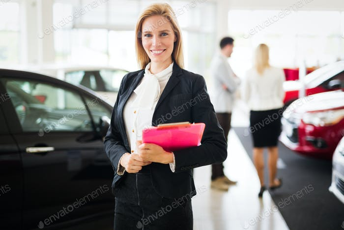 Professional gorgeous saleswoman at car dealership in formal wear. Super consultant and manager