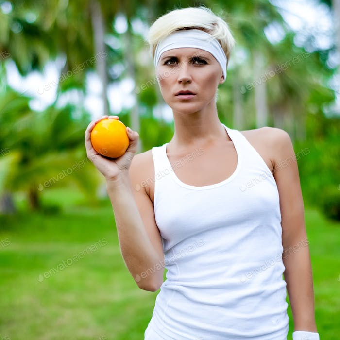 portrait of a young athletic girl with orange