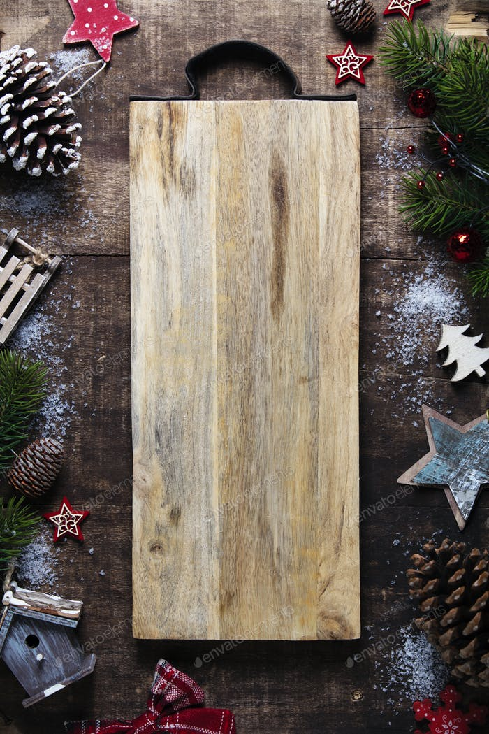 Christmas frame, wooden background