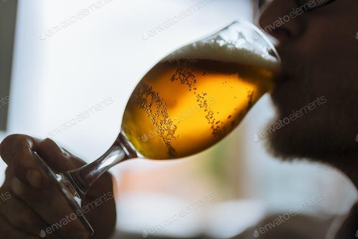Brewery worker drinking beer