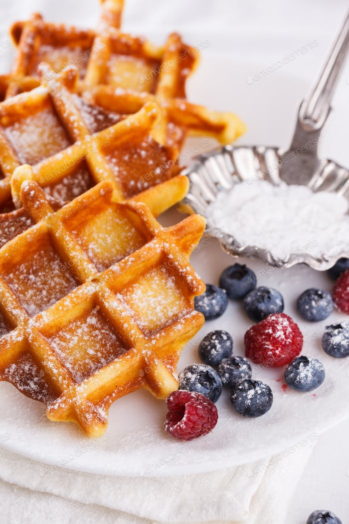 Belgian waffles with milk and fresh berries.