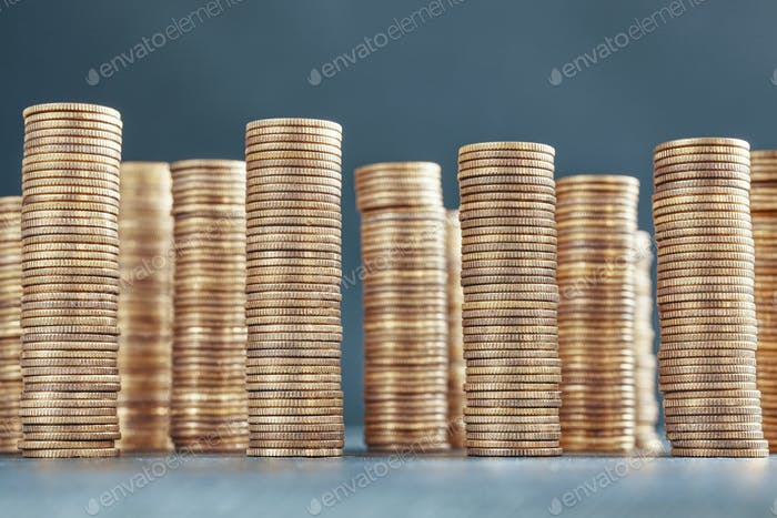 Stacks of golden coins, selective focus