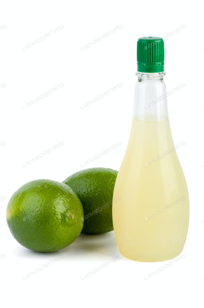 Two limes and bottle of juice