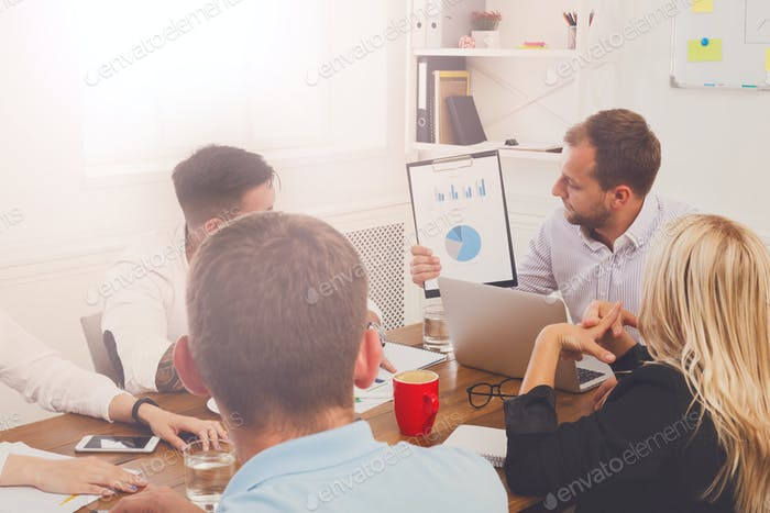 Business meeting. Young hipster businessman in modern office