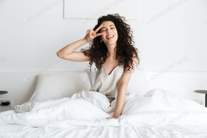 Smiling young girl with dark curly hair