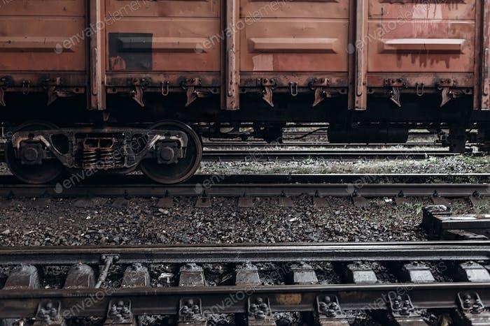 Carriage wheel on railway tracks closeup