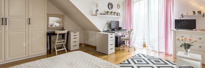 Bright attic bedroom with a wardrobe