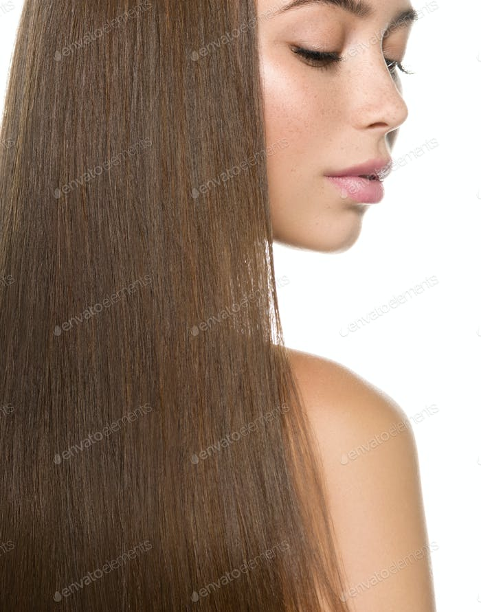 Beautiful freckles brunette woman with long smooth hair shine soft. Isolated on white. Studio shot.