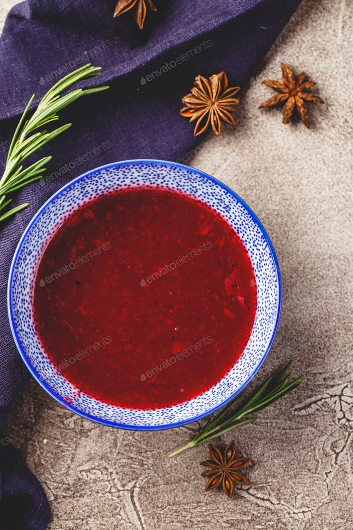Fresh cranberry apple sauce in blue bowl