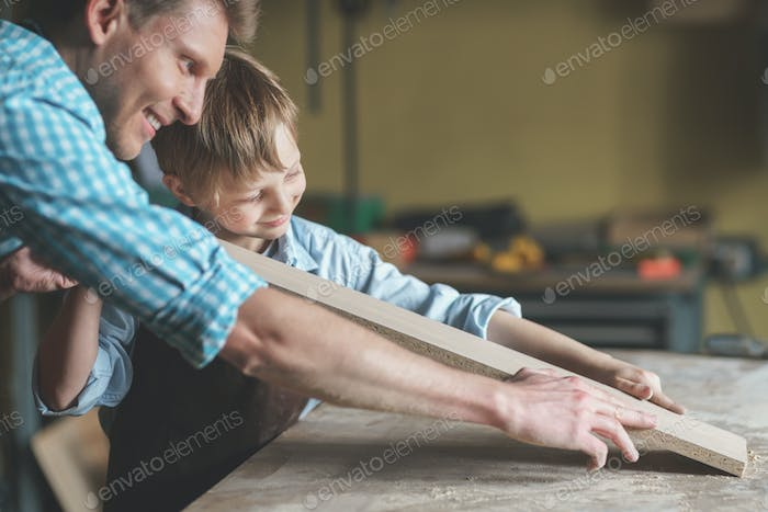 Smiling family in carpentry
