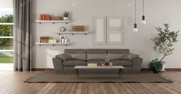 Modern living room with brown sofa and shelves with books on wall - 3d rendering