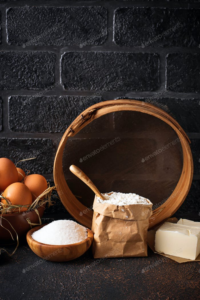 Ingredients for baking. Butter, eggs, sugar and flour