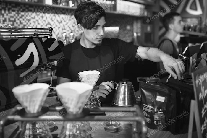 Barista at work in a coffee shop