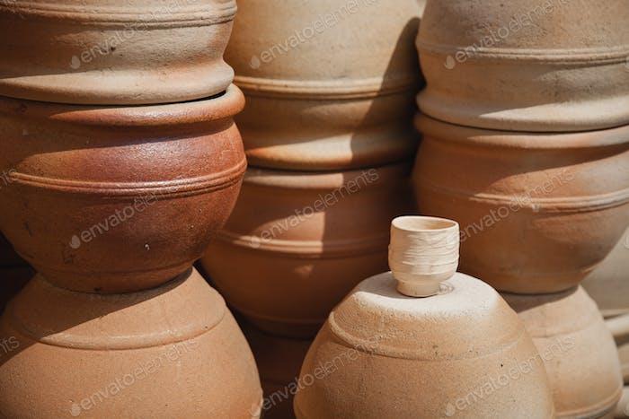 Huge roasted ceramic pots without glaze storage