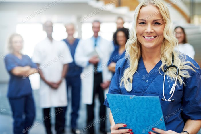 Cheerful woman in hospital looking at camera