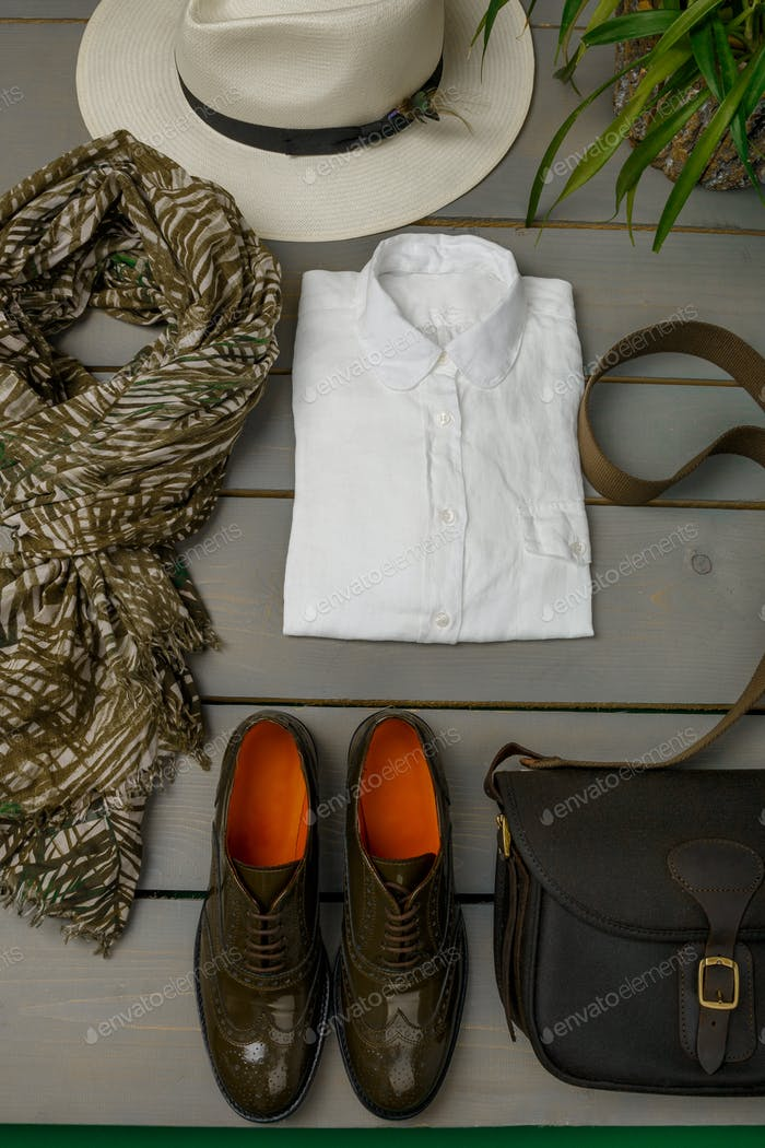Women's outfit on wooden background. fashion clothes.