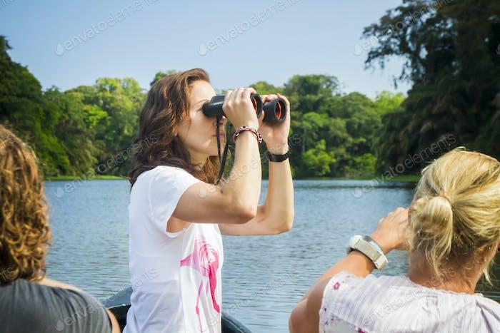 Girl Looking Through Binoculars From a Canoe in Costa Rica