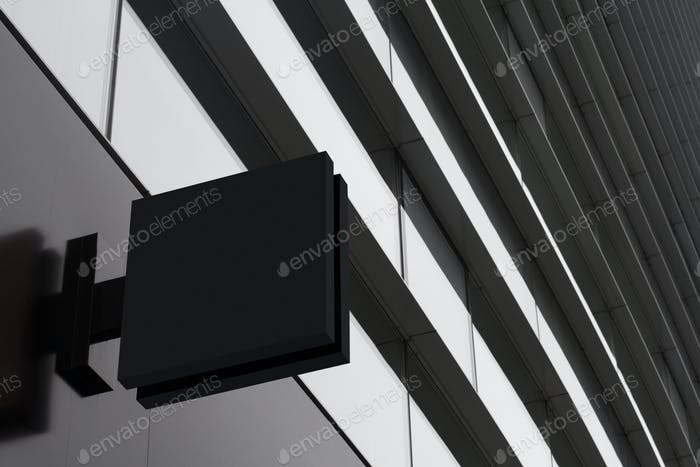 square empty signboard on a building with modern architecture