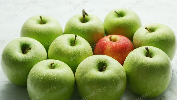 Green apples with red in heap