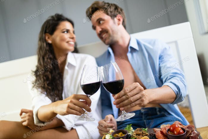Portrait of sexy attractive smiling woman eating salad