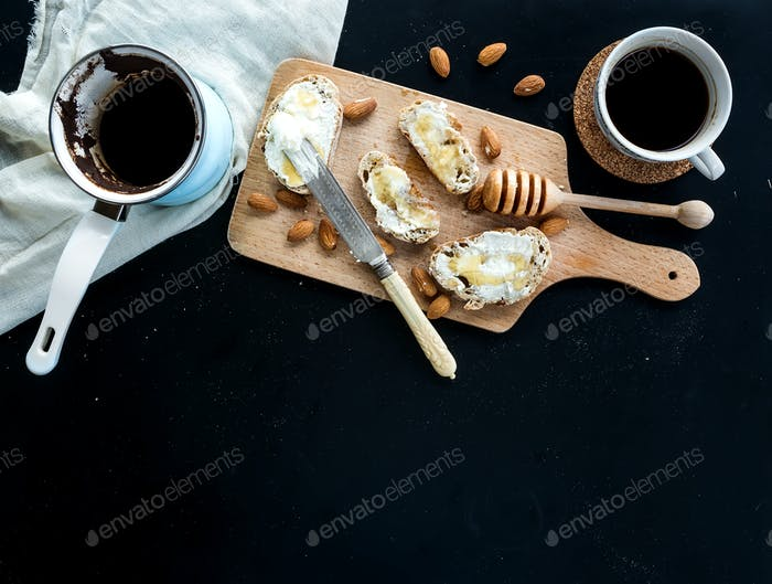 Breakfast set: pot or cezve of coffee, cup, kitchen towel, baguette slices