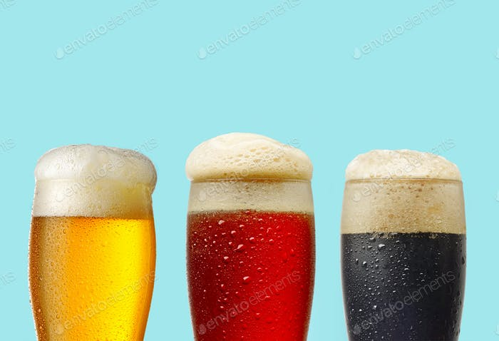 various beer glasses on blue background