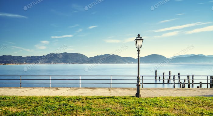 Massaciuccoli lake, terrace, street lamp and pier remains. Torre del Lago Puccini Versilia Italy