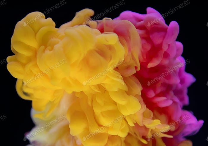 Abstract yellow and pink color drop to the water