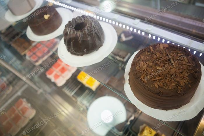 Display case with chocolate cakes at the bakery