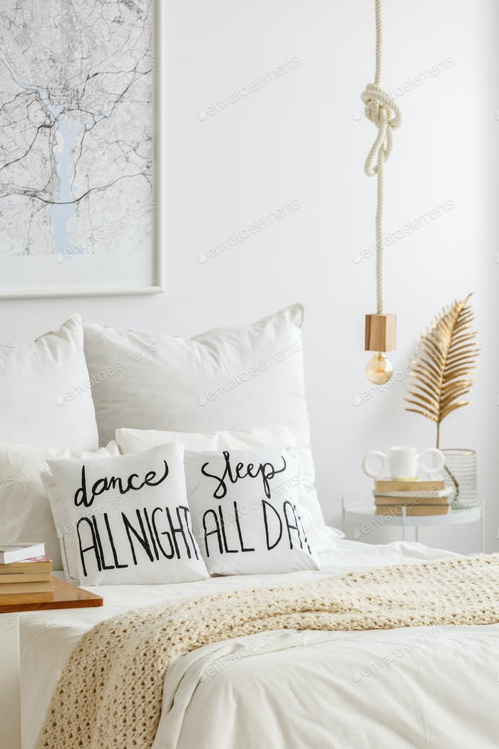 Bed with quote print pillows
