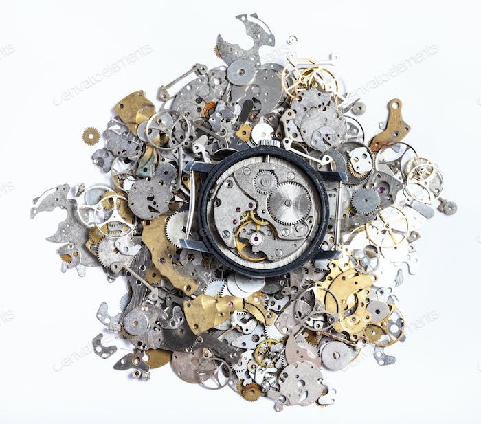 top view of mechanic watch on pile of spare parts