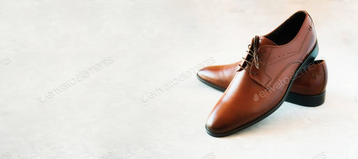Elegant fashion male shoes on gray background. Sale and shopping concept