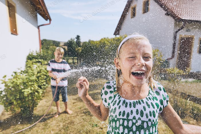Children having fun with splashing water