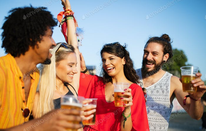 Happy young group of friends attending festivals at summer