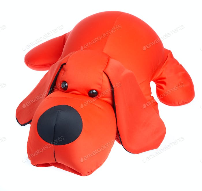 Red toy dog on a white background