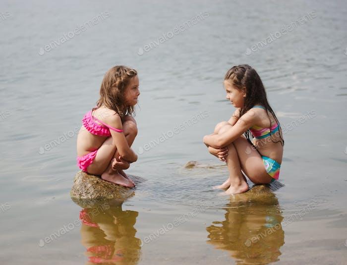 cute happy little girls in sumer lake