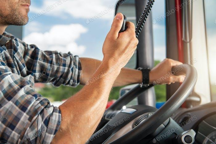Semi Truck Driver Talking on CB Radio
