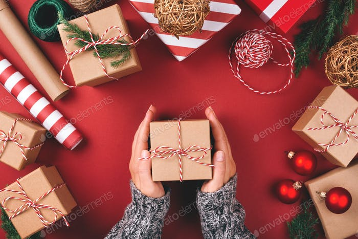 Christmas Background with Gifts and Female's Hands.