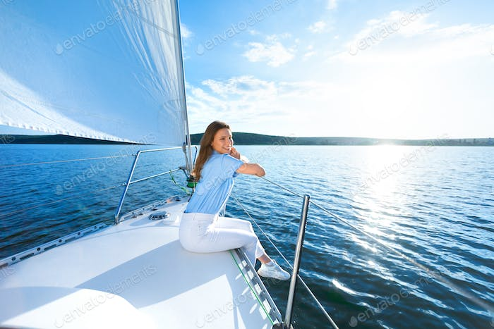 Woman Sitting On Yacht Relaxing Looking At Sea Sailing Outdoors