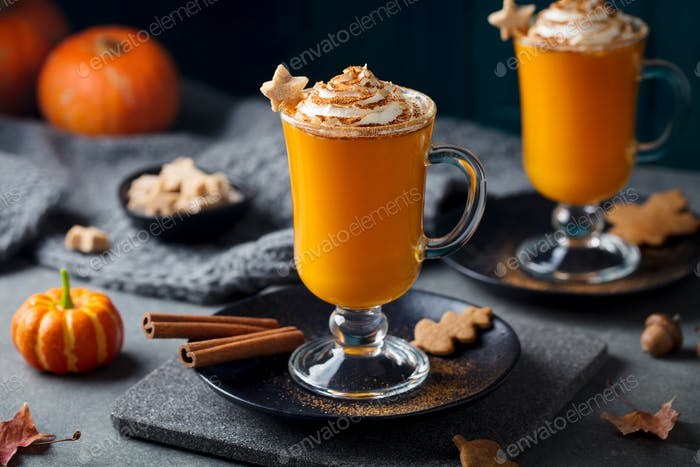 Pumpkin Latte with Spices. Boozy Cocktail with Whipped Cream on Slate Board. Grey Background.