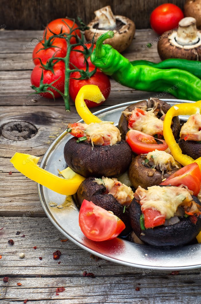 Easy appetizer of mushrooms stuffed with cheese,garlic and tomatoes.Rustic kitchen
