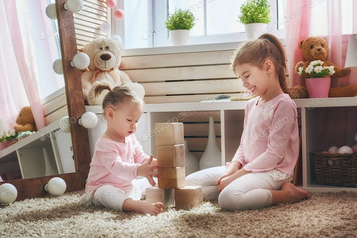 children are playing with blocks