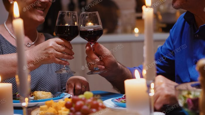 Couple dining together with wine